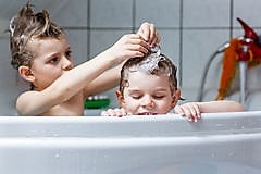 two-little-kids-boys-playing-together-bathtub-happy-siblings-twins-children-water-taking-bath-home-kid-having-fun-80132107