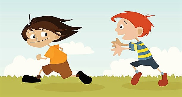 A boy and a girl playing chase.