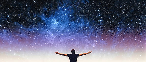 Silhouette of man and stars sky. Elements of this image furnished by NASA